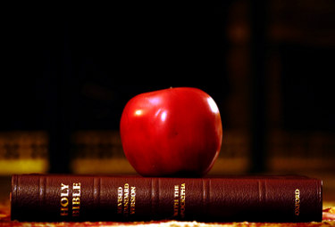 Apple on top of Bible