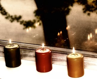 candles lined up on a windowsill