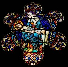 stain glass of the dead Christ with Mary